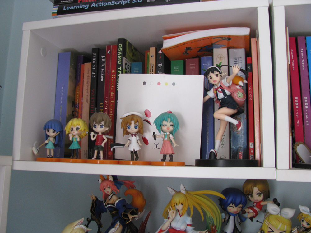 Book shelf with Higus and Mayoi-tan